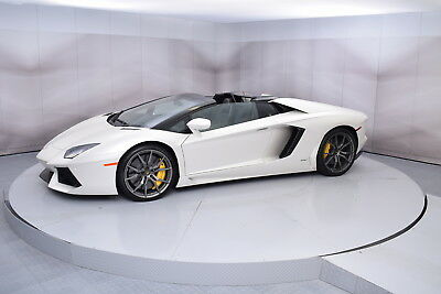 2015 Lamborghini Aventador Roadster in Bianco Canopus with 1,736 miles 2015 LAMBORGHINI AVENTADOR ROADSTER IN BIANCO CANOPUS AND NERO ADE LOW MILES