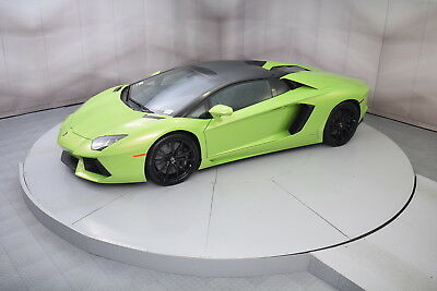 2016 Lamborghini Aventador Roadster in Verde Ithaca with only 1,317 miles 2016 LAMBORGHINI AVENTADOR ROADSTER IN VERDE ITHACA WITH NERO ADE INTERIOR