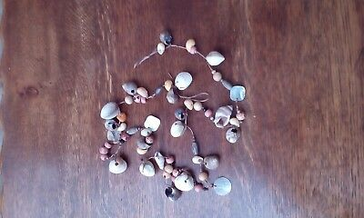 Delicate sea shell garland for home decor, glass beads wooden beads.