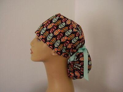 Ponytail Surgical Scrub Hat - Feathers - Multi color on Dark Brown
