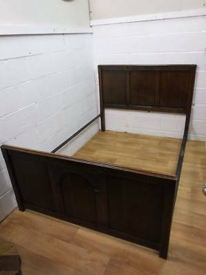 PRIORY STYLE DARK CARVED OAK DOUBLE BED 1930's WITH IRONS.