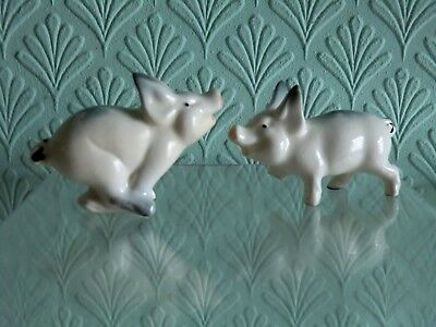 Two Vintage Beswick Piglets. Model Numbers 833 & 834. Both A/F.