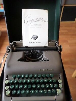 Vintage manual Smith Corona Sterling Typewriter with green keys manual + case