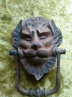 antique door knocker lion man mystical beast Aslan like