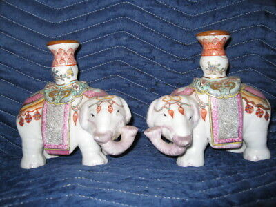 A pair of famille rose candlesticks holder 粉彩太平象一對