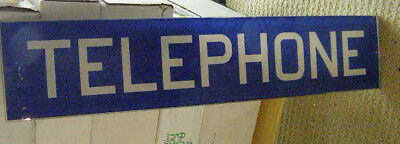 "Glass telephone sign ""TELEPHONE"" white letters with blue background"