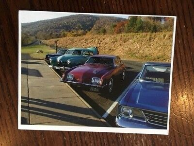 Studebaker Poatcard with 4 cars