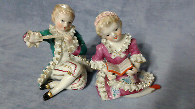 Vintage pair of girl and boy porcelain figurines