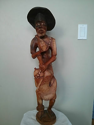 "Vintage 28"" Tall Hand Carved Wooden Sculpture Of A Native Man"