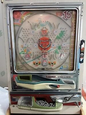 Vintage Nishijin Pachinko Machine Game with about 750 balls.