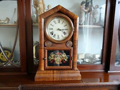 Antique steeple chimes mantle clock may be American perfect working order