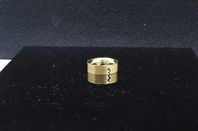 New 18ct yellow gold ring set with 1 diamond 0.02ct the diamond is tension set b