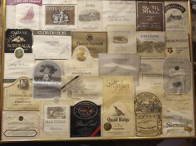 Wine labels signed by the maker or makers 27 labels total framed