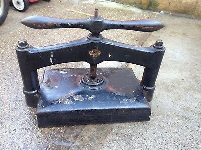 Vintage cast iron and brass book press