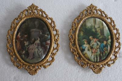 A Pair Of Vintage Minature Oval Metal Framed Silk Picture Of Figures And A Dog.