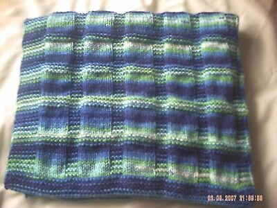 Striking Hand Knitted Striped Baby Blanket In Greens And Blues.