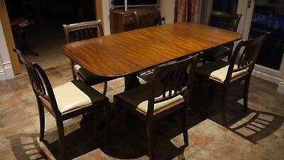Regency style mahogany dining table and chairs