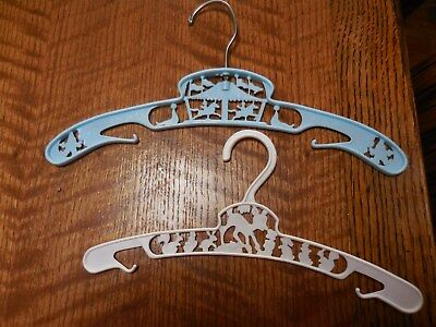 Two Vintage Plastic Baby Clothes Hangers Blue Circus & White Disney Bambi