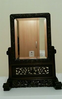 A Chinese antique mirror, 19th century.