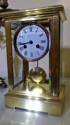 Antique French Brass Four Glass Mantel Clock.