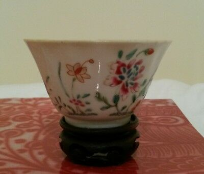 A Chinese antique porcelain tea bowl with a stand, 18th century.