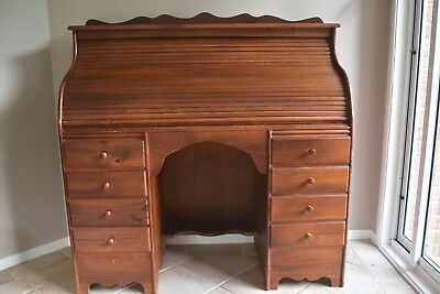 Roll top desk with 8 drawers in stained pine