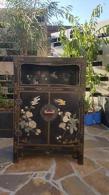 Chinese black lacquer cabinet decorated with green and white jade carvings