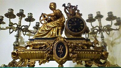 Antique French Gilt and Black Stone Figural Mantel Clock.