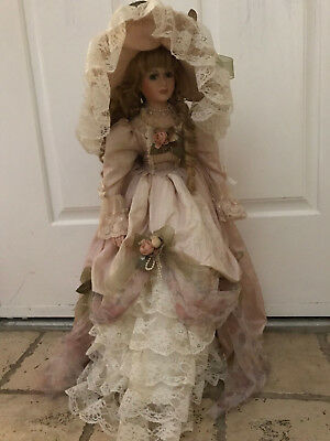 Antique Porcelain Doll with handmade clothing