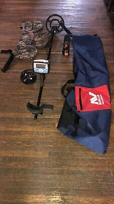 Minelab X-Terra 705 Metal Detector, with a plunger coil, shovel and bags.