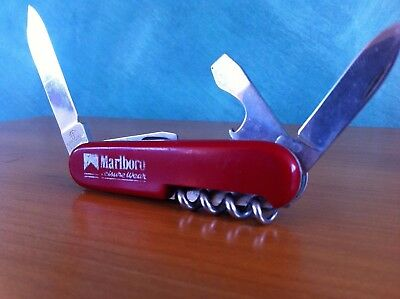 Rare vintage collectible Victorinox Officer Swiss Army knife with leather pouch
