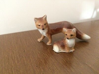 China Figurine Pair of Foxes