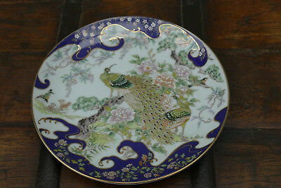 small plate in Japanese porcelain with peacocks