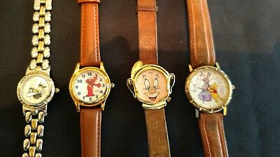 Lot of 4 Character Watches Pooh Disney Sesame Street Sylvester