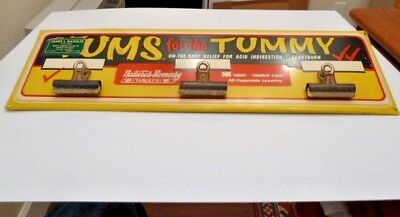 Vintage Metal Painted Sign Advertising Tums Anti Acids that has 3 paper clasps