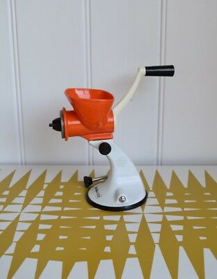 Vintage Spong Mincer N705 Orange with suction base. Retro kitchen appliance