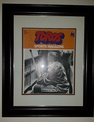Framed 1974 WHA Toros Program with AUTOGRAPHS including 2 of 3 Howe's