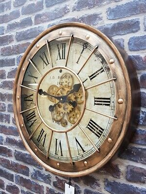 Large round brass moving gear Roman numerals clock