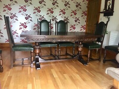 Extending Period style Renaissance Oak Refectory Table with 6 matching chairs.