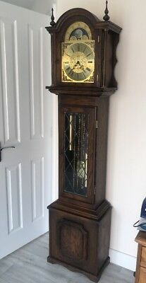 A Quality Fenclocks Three Tune Long Cased Clock With Moon Roll Dial