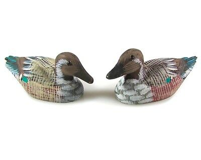 Collection of hand-carved wooden ducks, hand-painted