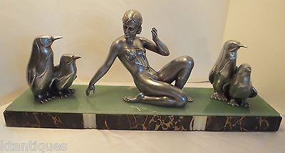 Art Deco Sculpture Of A Demure Woman With Four Pet Penguins On Marble Onyx Base
