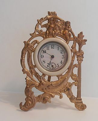 Antique Ansonia Clock Shelf USA Gold Tone Cherub Design Celluloid Face Works