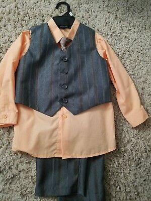 Boy's 4 Piece Suit, peach and gray in color. Worn once. Size 4T.