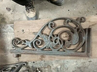 Large pair of ornate cast iron Victorian style brackets with Monkey design.