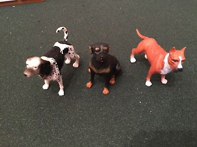 three toy model dogs boxer rottweiler coonhound