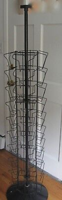 "Card Display Rack, Stands 64"" Tall, Features 8 Separate Slots on 4 'Sides.'"