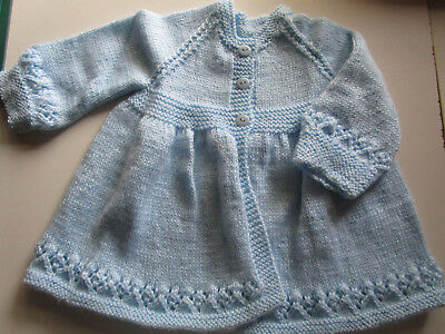 babies hand knitted jacket