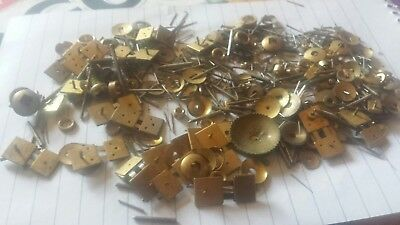 Vintage clock parts pins colers and more..