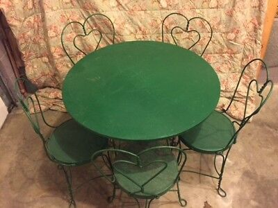 Antique Ice Cream Table and Chairs with hard to find heart backchairs.